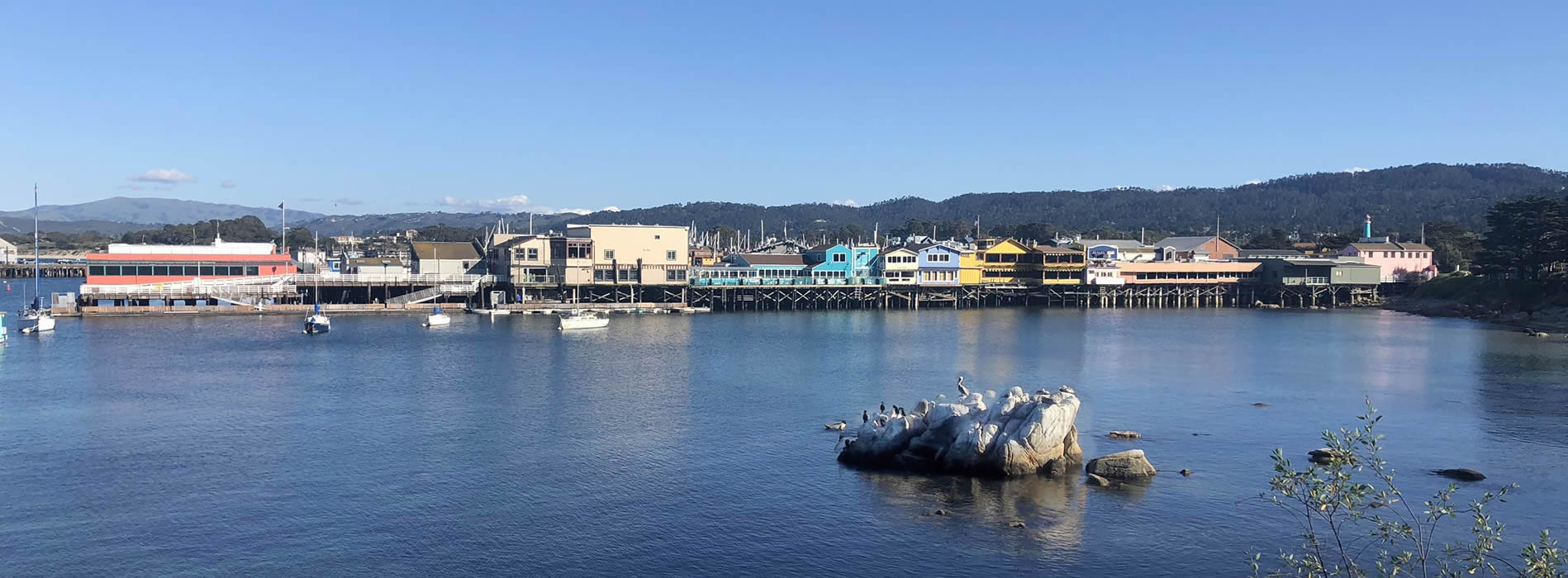 the monterey wharf with colorful shops and restaurants